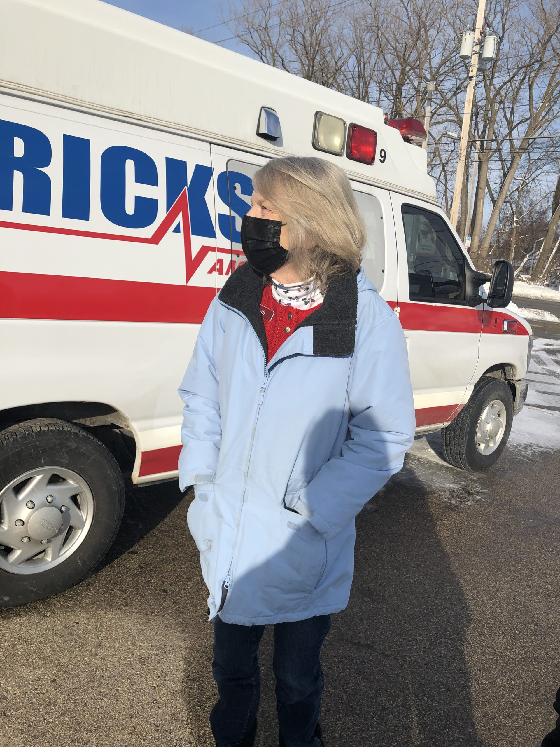 Barb waiting to surprise our local ambulance team with a special gift