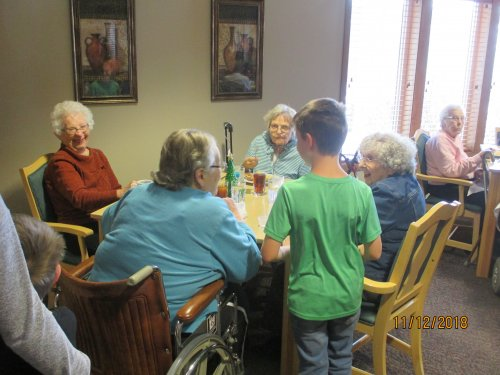 Residents enjoying a visit from the many groups caroling over the holidays.
