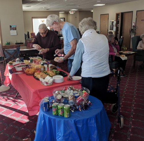 Some of our veterans enjoying the Veterans Day spread that Primrose put on for them.