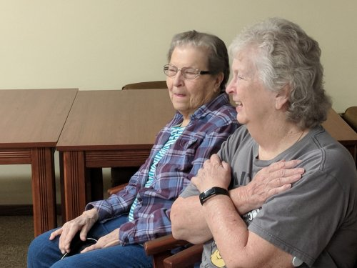 Two of our residents getting in the groove doing dancersise.
