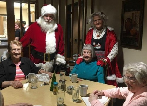 some of our ladies enjoying a visit with Santa and Mrs. Claus!
