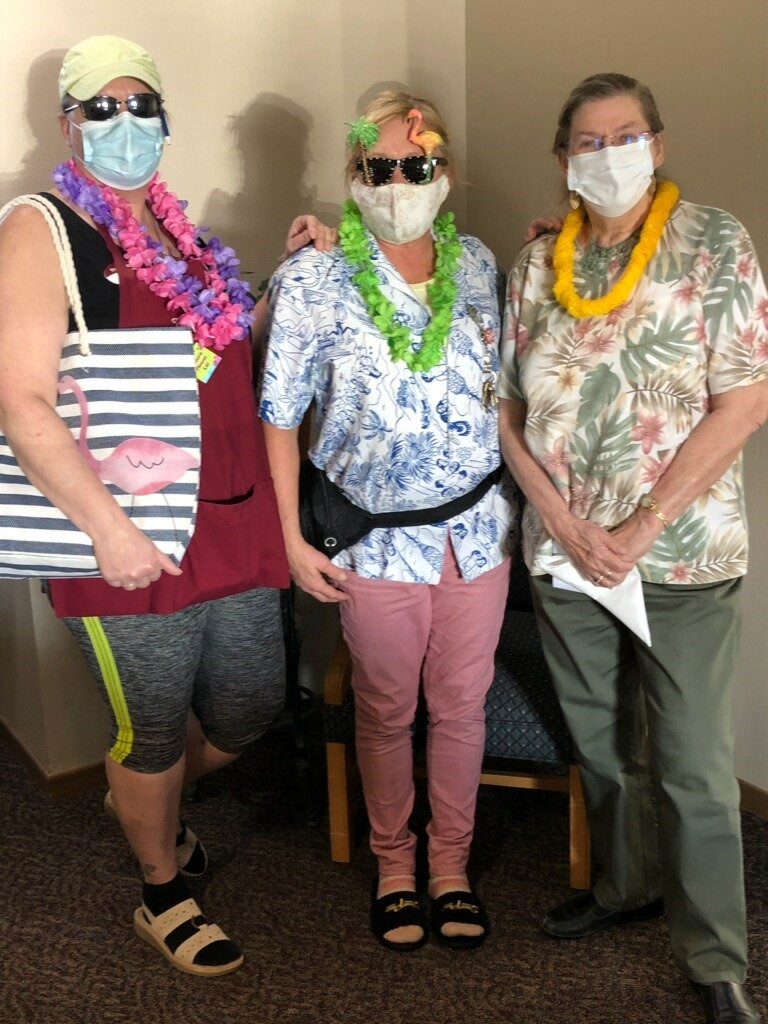 residents and staff show up for tropical day