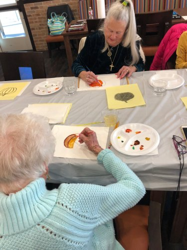 Primrose Residents joined in the creative fun of a Watercolor Painting Class where they painted pictures of pumpkins, harvest apples, pick-up trucks, and squirrels!