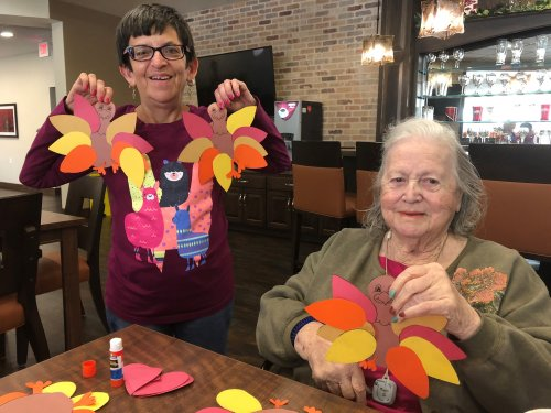 Angie and Pauline showing off the Thanksgiving Turkeys they made to place on Primrose Resident doors!