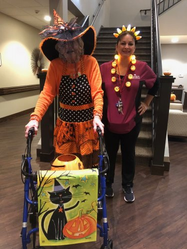 Liz was all dressed up as a festive witch and our CNA, Marlienne as a glowing candy corn queen for the Primrose Halloween Party!