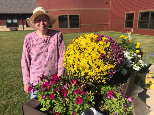 One of our residents, Zeta, can be found near the Primrose Garden Bed using her green thumb to plant beautiful flowers and plants for residents to see outside the Dining Room windows!