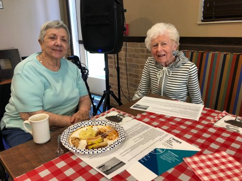 Marilyn and Joan enjoy themselves at the Resident/Staff Cookout where food was provided by several local health organizations and residents could donate money to try to dunk staff members in a dunk tank!