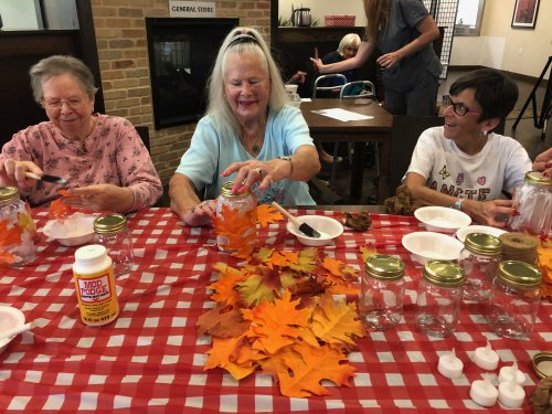 Residents spent a fun afternoon making Autumn Leaf Mason Jar Centerpieces for all of the dining room tables!