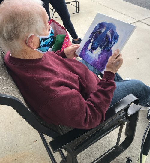 Happy Birthday to our awesome resident and US Marine veteran, John! His family surprised him with a colorful yard sign and a portrait painted by his Granddaughter of his beloved dog, London!