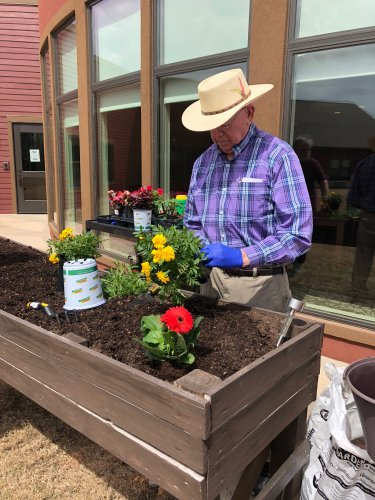 Sam began planting spring flowers in the Primrose Garden Box which will be be beautiful to see outside the Dining Room! April Showers bring May Flowers!