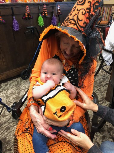 Liz loved spending time with the Staff's children at the Primrose Halloween Party! Little Nemo 'Hudson' seemed right at home in Liz's arms!