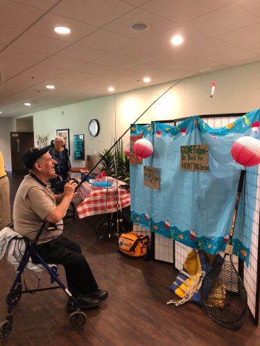 Walter playing 'Fish For A Prize' at the Fishing Themed Father's Day Luncheon full of musical entertainment by staff members, fishy snacks bar, and celebrating the men in our lives!