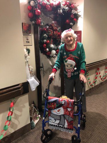 Our fabulous resident, Liz is ready for the Christmas season with her festive outfits and beautifully decorated door!