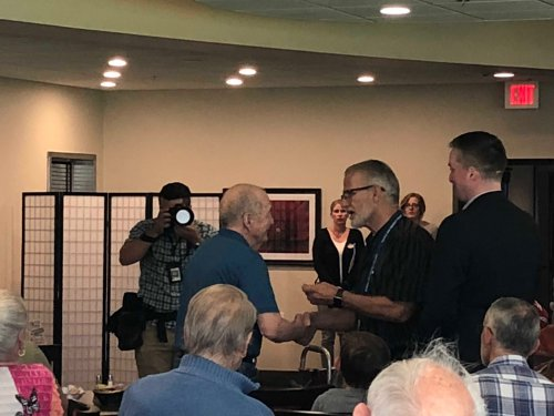 Charles receiving his Veteran Pin during the Primrose Veteran Pinning Ceremony facilitated by Arkansas Hospice's Doc Kenser and Corporal Aaron Mankin. Residents were awarded their pin and then saluted by the two veterans.