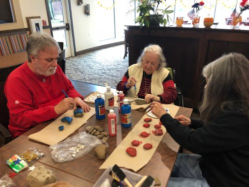 Kevin, Pauline, and Rosemarie painted 'Thank You For Your Service' rocks and created We Love Our Veteran's posters for the Primrose Veteran Program!