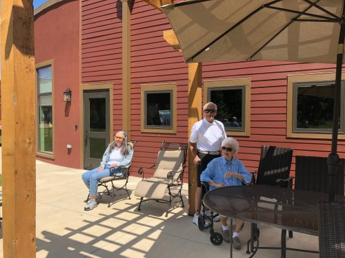 Residents catching some sunshine while they wait for the Resident/Staff Cookout and a dunk tank where residents could dunk staff members!