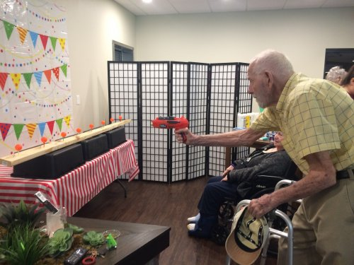 Residents celebrated National Fair Month by participating in Midway Games every Friday during lunch for prizes! Gil was sure his shooting skills were up to par!