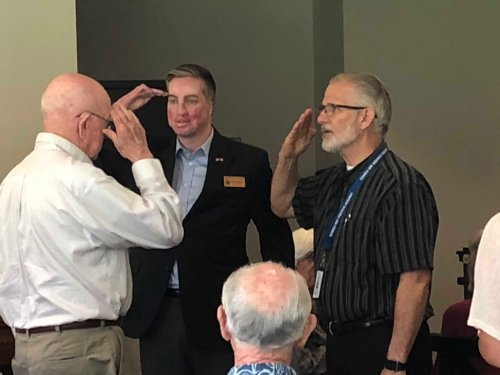 Sam receiving his Veteran Pin during the Primrose Veteran Pinning Ceremony facilitated by Arkansas Hospice's Doc Kenser and Corporal Aaron Mankin. Residents were awarded their pin and then saluted by the two veterans.