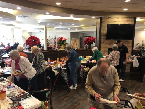 Residents get their last minute Christmas shopping done at the monthly Primrose General Store! Residents collect Primrose Bucks all month long from attending activities, playing games, reading books, working word puzzles, ect. then get to spend their money on goods and seasonal items!