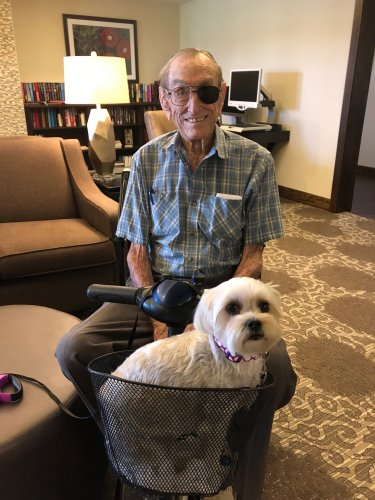 One of our residents, Bill posing with his Granddog, Mollie while she waits patiently to be presented in the Primrose Pet Show Fundraiser for the Alzheimer Association's The Longest Day event!