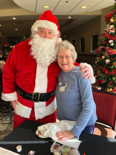 Luetta is greeted by Santa Clause during the Primrose Resident Christmas Luncheon! Residents were treated to a luncheon of Beef Burgundy, a piano performance and were delivered cards and candy canes by Santa Clause himself!