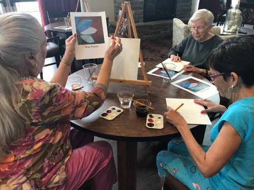 Villa ladies were tapping into their creative sides while attending a Painting Class where they painted a May Flower with Blaire in the Clubhouse.