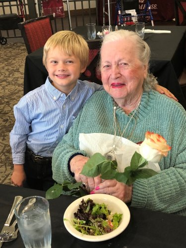 Pauline receives a rose and a hug from our Sales Leaders son, Kaden at the Resident VIP Dinner! Residents were treated to a delicious meal, cocktail hour, and a cello performance!