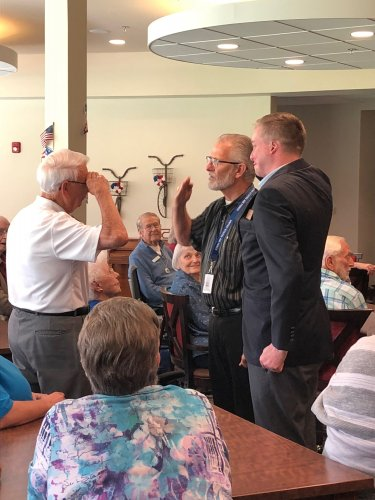 Len receiving his Veteran Pin during the Primrose Veteran Pinning Ceremony facilitated by Arkansas Hospice's Doc Kenser and Corporal Aaron Mankin. Residents were awarded their pin and then saluted by the two veterans.