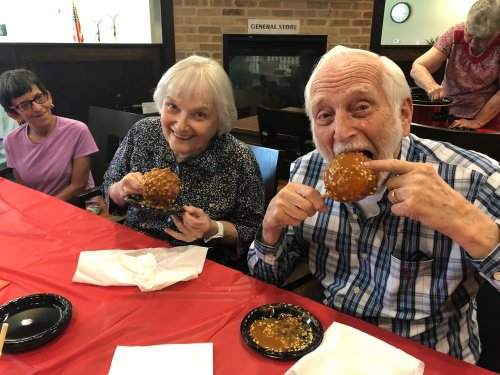Lynn and Ken enjoying the Caramel Apples they made for National Fair Month!