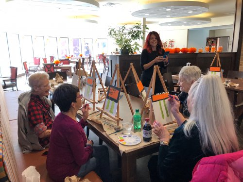 On Halloween, residents participated in a Halloween painting class with our bus driver, Valarie! They painted a witch holding up a sign that simple wishes everyone, 'Happy Halloween!'