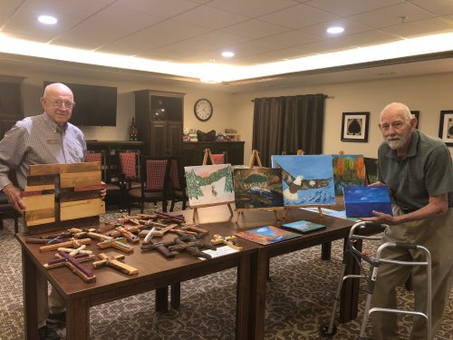 To celebrate the theme of Assisted Living Week, 'A Spark of Creativity', residents displayed their homemade art for the community to view! Sam displayed his driftwood and jewelry crosses and Gil displayed a variety of his paintings!