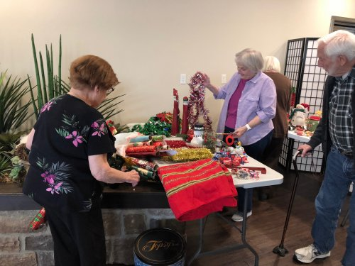 Residents choose which Christmas decor they wanted to decorate their doors with and then voted all month long on their favorite decorated door!