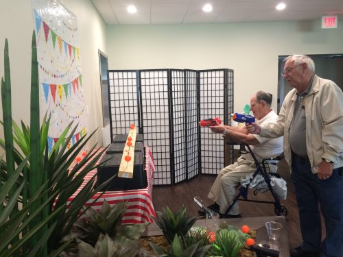 Walter and Bob shoot off against one another to celebrate National Fair Month with the Friday Midway Games for Prizes!