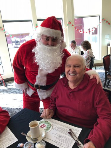 Jack is greeted by Santa Clause during the Primrose Resident Christmas Luncheon! Residents were treated to a luncheon of Beef Burgundy, a piano performance and were delivered cards and candy canes by Santa Clause himself!