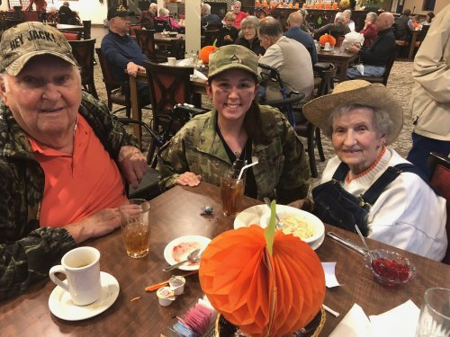 Margaret the Farmer and Jack the Hunter pose for a photo with Primrose CNA, Karen during the Primrose Halloween Party! Resident and Staff member's relatives trick or treated table to table followed by a costume contest!