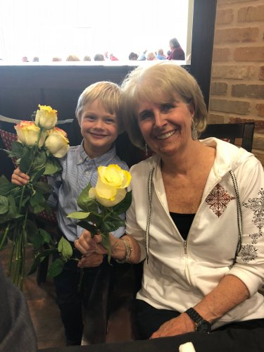 On our two year anniversary of our community being opened, residents were treated to a VIP Dinner served by the Leadership Staff and our Sales Directors son, Kaden handed out roses and hugs to all of our Primrose Ladies!