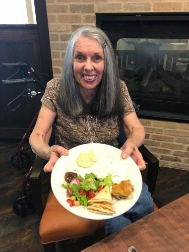 Spirit Week Day #2 Tropical Staycation! RoseMarie shows off her Greek appetizers sample plate from Taziki's Mediterranean Restaurant during the Greece Presentation.