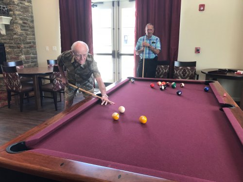 Bud and Paul compete in a fun game of Pool in the Primrose Villa Clubhouse!