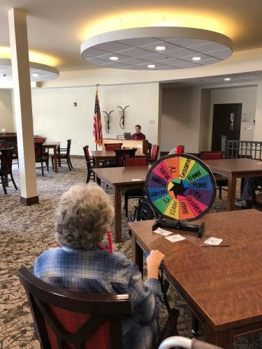 One fun afternoon our residents played a game of Name That Tune where they would spend a wheel to land on a music genre then our assistant Kyle would play a tune on the Primrose Piano and let the residents guess the tune for Primrose Bucks!