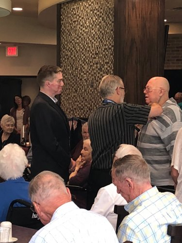Mike receiving his Veteran Pin during the Primrose Veteran Pinning Ceremony facilitated by Arkansas Hospice's Doc Kenser and Corporal Aaron Mankin. Residents were awarded their pin and then saluted by the two veterans.