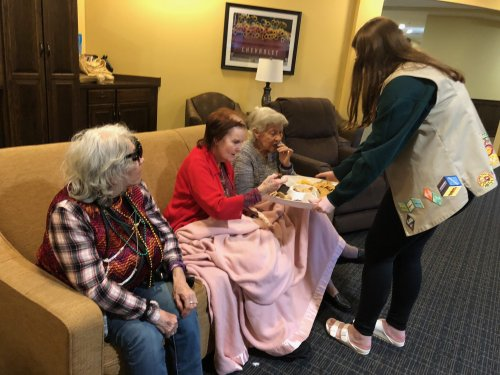 To celebrate National Girl Scout Week, our local Girl Scout troops brought Girl Scout cookies for residents to enjoy and serenaded them with some good ol' Campfire Songs!