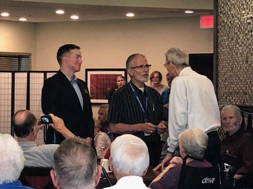 Leroy receiving his Veteran Pin during the Primrose Veteran Pinning Ceremony facilitated by Arkansas Hospice's Doc Kenser and Corporal Aaron Mankin. Residents were awarded their pin and then saluted by the two veterans.
