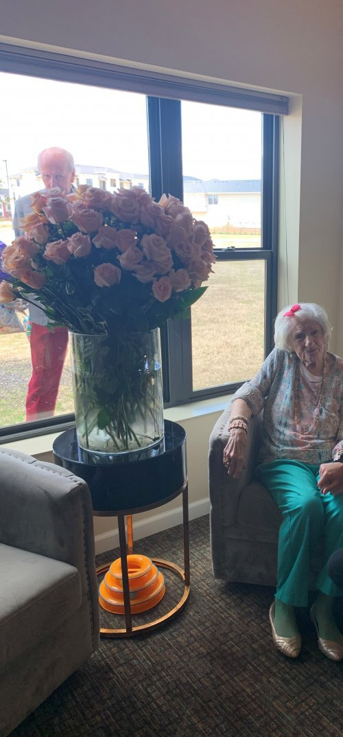 Each year Liz receives a rose on her birthday for the amount of years she has been alive - this year she received 94 blush-colored roses, her church choir singing out her window and a beautiful yard sign! Happy 94th Birthday Liz!