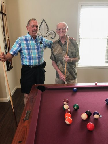 The friends that play pool together- stay together! Bud and Paul get ready to out-do each other at a game of pool in the Primrose Villa Clubhouse!
