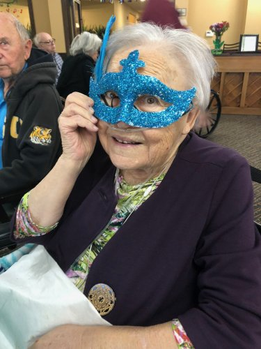 Thelma showed off her handmade Mardi Gras masked the residents made to wear during the Fat Tuesday Lunch Celebration with Gumbo, Crab Cakes, Punch, and King Cake!