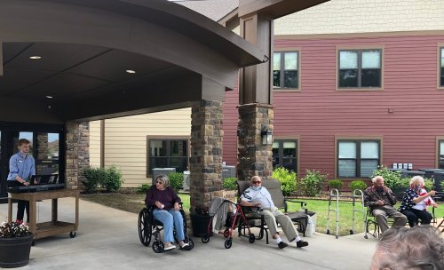 Residents gathered after lunch to hear our Activities Assistant, Kyle play Patriotic songs in the front yard! Residents enjoyed ice cream sandwiches and sang along to songs of the armed forces! At 3pm, residents and staff took a moment of remembrance for all the soldiers who lost their lives in the service.