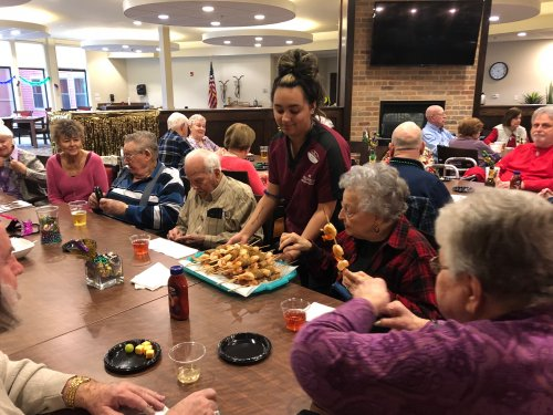 Residents gathered together during Fat Tuesday evening for a Mardi Gras inspired Happy Hour! Our wonderful server, Alexis passed around Shrimp and Cajun Sausage skewers to the crowd as residents shared stories of times spent in New Orleans!