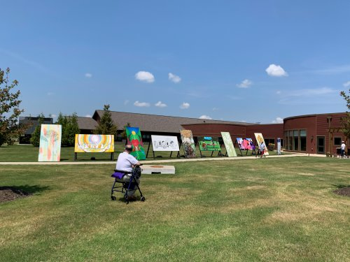 Our Primrose residents were treated to the Crystal Bridges Social Campaign on a sunny afternoon! Residents and staff were able to view local artists paintings of Togetherness and each person received watercolor kits and copies of the paintings to take home!