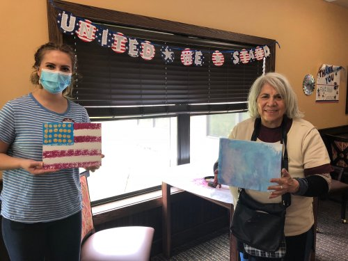 Our Memory Care LEC, Melissa led a very fun sponge painting class where residents created American Flag paintings for Memorial Day! Clara was proud to show off her painting and had a great time!