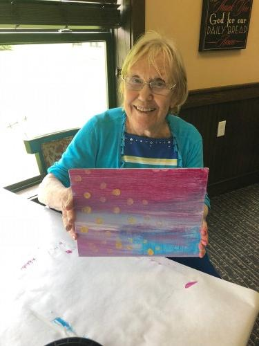 Our Memory Care LEC, Melissa led a very fun sponge painting class where residents created American Flag paintings for Memorial Day! Susan had a great time and was proud of her painting!